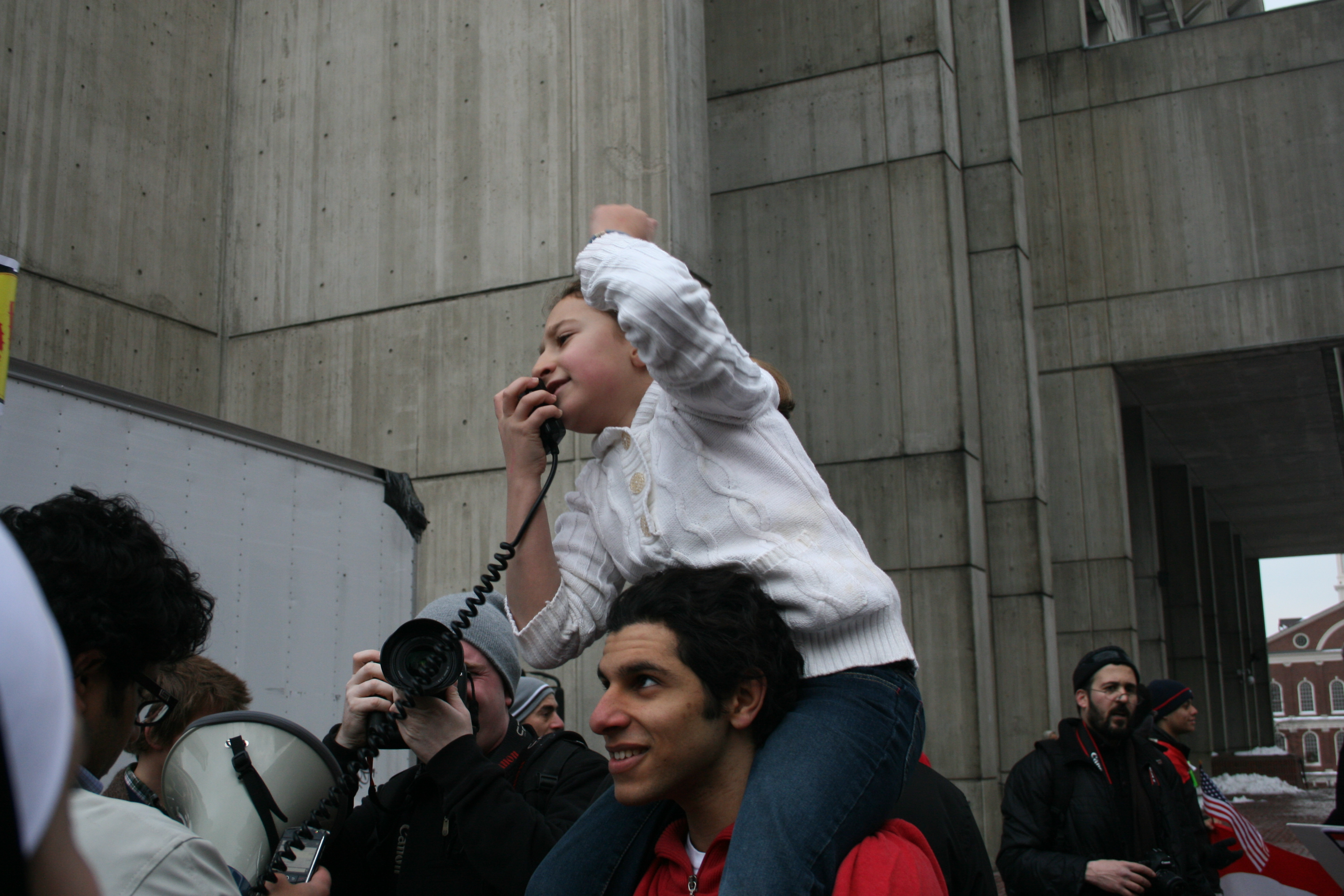 A young girl leads the chanting